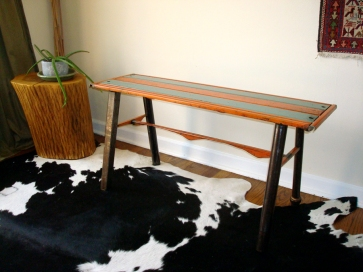 "Slat bench- 40"" L/ 20"" W/ 19"" H. Salvaged steel vintage metal awnings, plumbing fittings and pipes for legs."