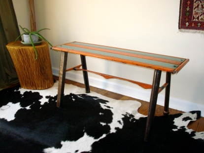 """Slat bench- 40"""" L/ 20"""" W/ 19"""" H. Salvaged steel vintage metal awnings, plumbing fittings and pipes for legs."""
