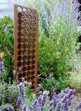 """scrap column - three versions of scrap punched or perf steel with a stake base - 30"""" H x 8"""" W"""