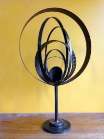 """Planetary- 31"""" W orb, total height 4' H. Reclaimed see, rotor, pipe laser cut disc, strap steel."""