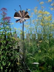 """steel flower - round base 6'4""""H x 12"""" W face"""