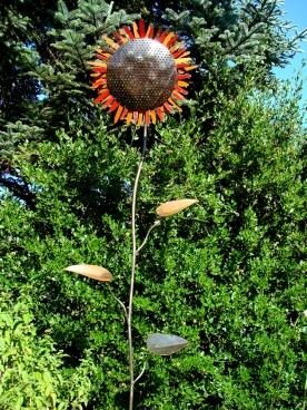 "sunflower - red christmas tree basin, orange railing, scrap perf steel on square base - 18""W face x 7' H"