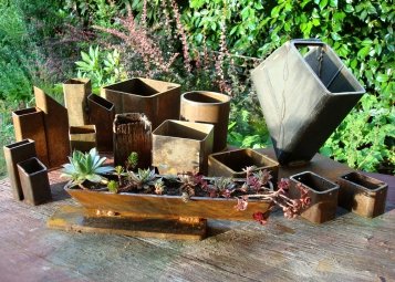 summer planters - variety of planters from scrap steel and industrial drops