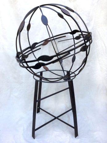 """Offset Orb on stand- 30""""W x 50""""H."""