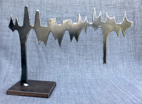 "Squinting at Disaster-Plasma cut steel, 12""H x 12""W."