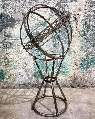 """Lace Orb on base- 19""""Wx38""""H. Reclaimed steel, expanded mesh, stainless uni-thread, stole legs."""