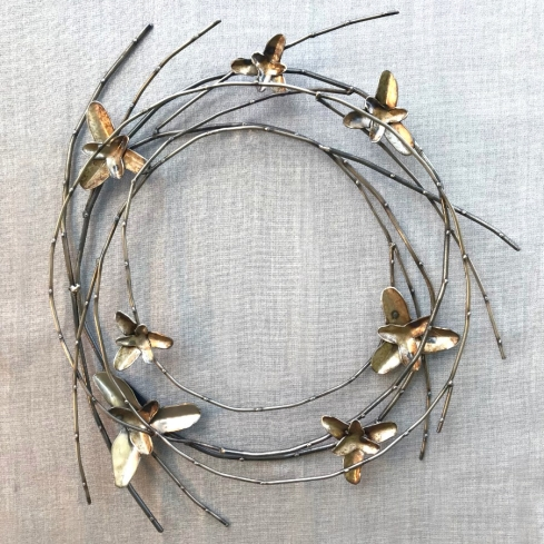 "Willow Wreath with Wild iris, 23""W, plasma cut steel, hand form steel and welded rod."